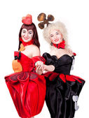 Two queens of hearts and clubs — Stock Photo