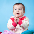 A baby on the blue backgraund — Stock Photo