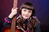 A girl with guitar — Stock Photo