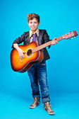 A boy with guitar — Stock Photo