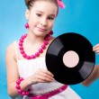 Beauty girl with records — Stock Photo #10641425
