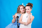 Two girls with microphone — Stock Photo