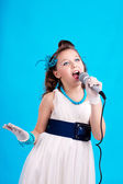 Beatifull girl with microphone — Stock Photo