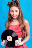 A girl with vinyl record — Stock Photo