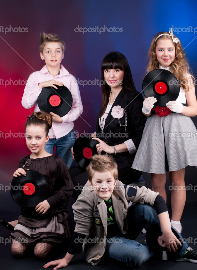Portrait of five with vinil records on the black background  Stock Photo #10649859