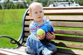 A little boys on the bench — Stockfoto