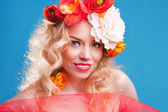 A romantic woman with the red flower — Stock Photo