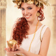 Greek goddess with gold apple — Stock Photo #10734081