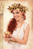A greek goddess with the gold apple — Stock Photo