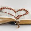 Stock Photo: Old hymnal and rosary