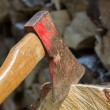 Axe in front of a stack of wood — Stock Photo