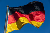 German flag isolated from blue sky — Stock Photo