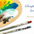 Artist palette , colors and paintbrushes — Stock Photo #10501326