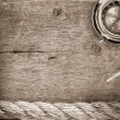 Ship ropes and compass  on old wood - Stockfoto
