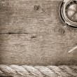 Ship ropes and compass  on old wood -  