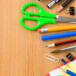 Back to school concept and supplies on wood — Stock Photo