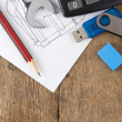 Office supplies on drafting over wood — Stockfoto
