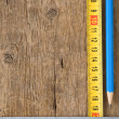 Stock Photo: Pencil and tape measure on wood