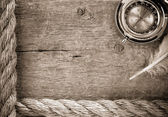 Ship ropes and compass on old wood — Stock Photo
