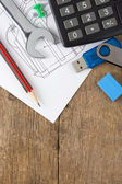 Office supplies on drafting over wood — Stock Photo