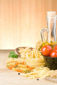 Pasta and food ingredient on wood — Stock Photo