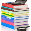 Pile of books and pens on white — Stock Photo