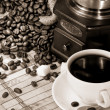 Cup of coffee and grinder with beans — Foto Stock