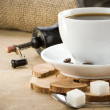 Stock Photo: Cup of coffee and grinder