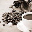 Stock Photo: Cup of coffee and grinder with beans