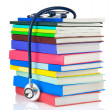 Stethoscope and pile of books isolated on white - Stock Photo