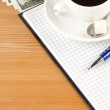 Notebook and coffee with dollar — Stock Photo