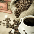 Cup of coffee and grinder - Stock Photo