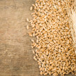 Ears spike and wheat on wood texture - Stock Photo