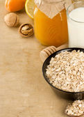 Cereals and healthy food on wood — Stock Photo