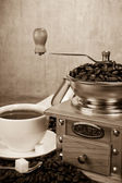 Cup of coffee, beans and grinder — Stock Photo