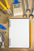 Tools and pad on wood — Stock Photo