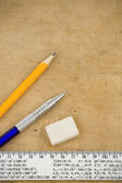 Pen, pencil and ruler on wood — Stock Photo