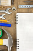 Pad and tools on wood — Stock Photo