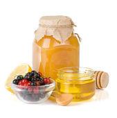 Glass jar full of honey, lemon and berry — Stock Photo