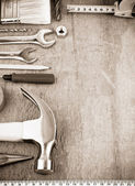 Tools and instruments on sepia — Stock Photo