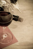 Glass of red wine and bottle — Stock Photo