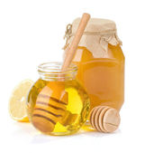 Glass jar full of honey and lemon — Stock Photo