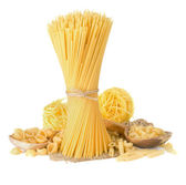 Pasta and wooden spoon on white — Stock Photo