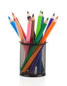 Färgglada pennor i hållare korg på vit — Stockfoto