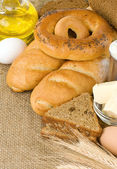 Bakery products and grain on sack — Stok fotoğraf
