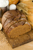 Bread and bakery products on wood — Stock Photo