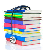 Stethoscope and pile of books isolated on white — Stock Photo