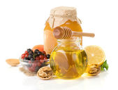 Glass jar full of honey, lemon and berry — Stock Photo