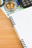 Notebook and euro with compass — Stock Photo
