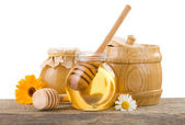 Jar of honey and stick — Stock Photo
